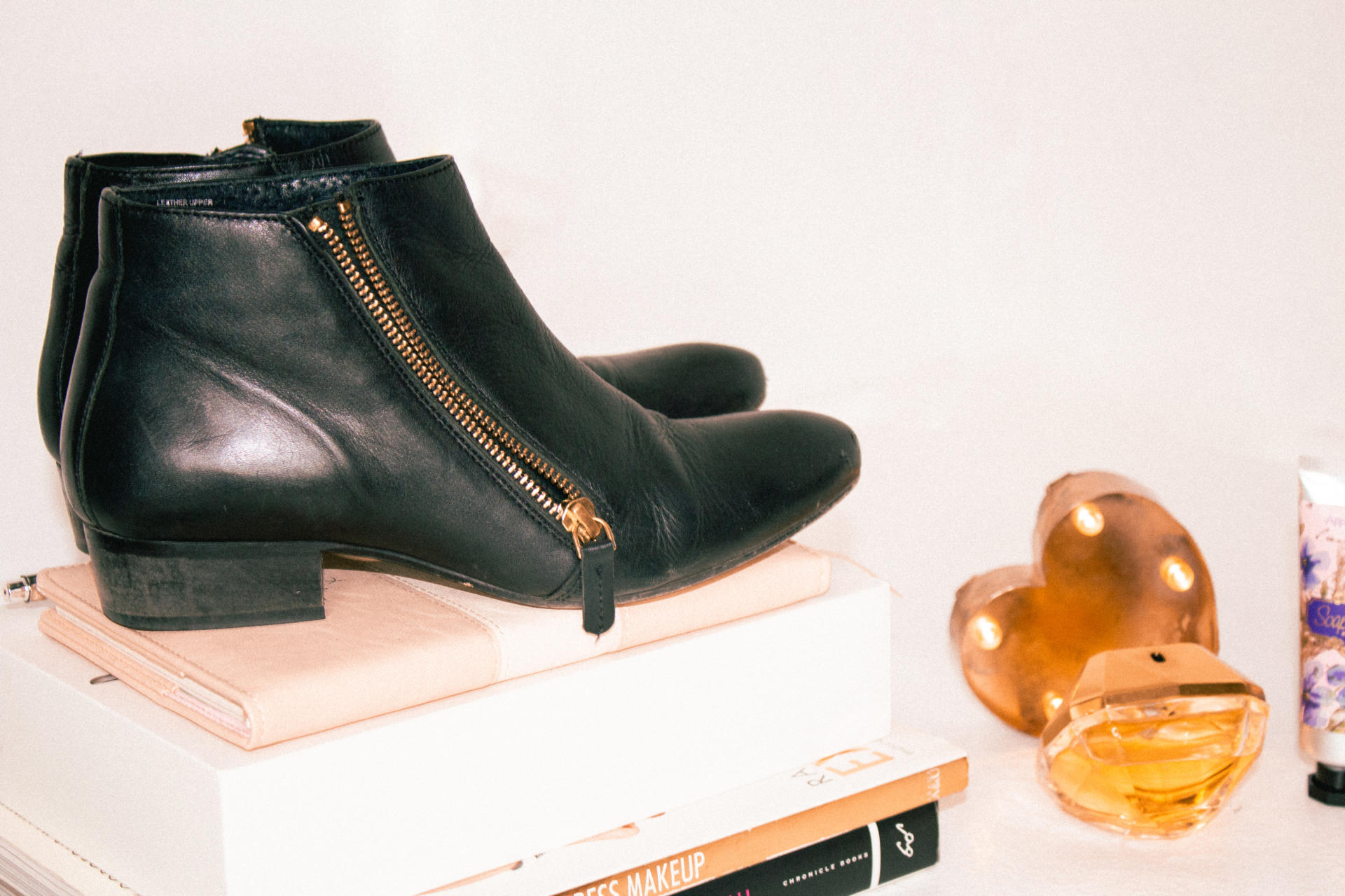 Ankle boots on books